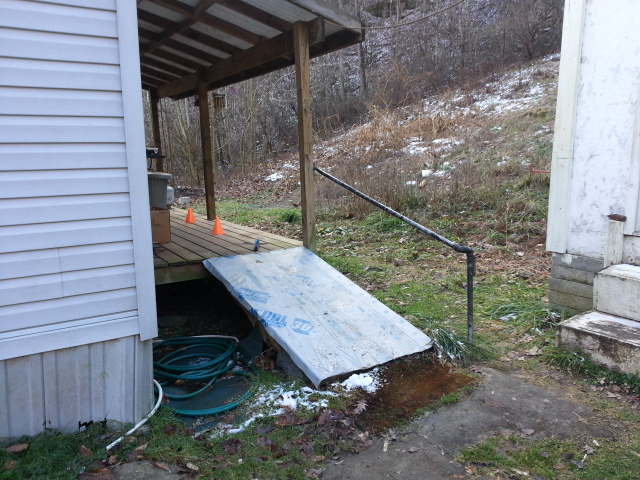Image of an unsafe preexisting ramp wooden ramp