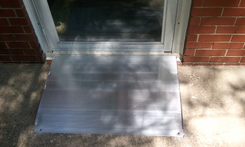 Doorway with aluminum threshold installed