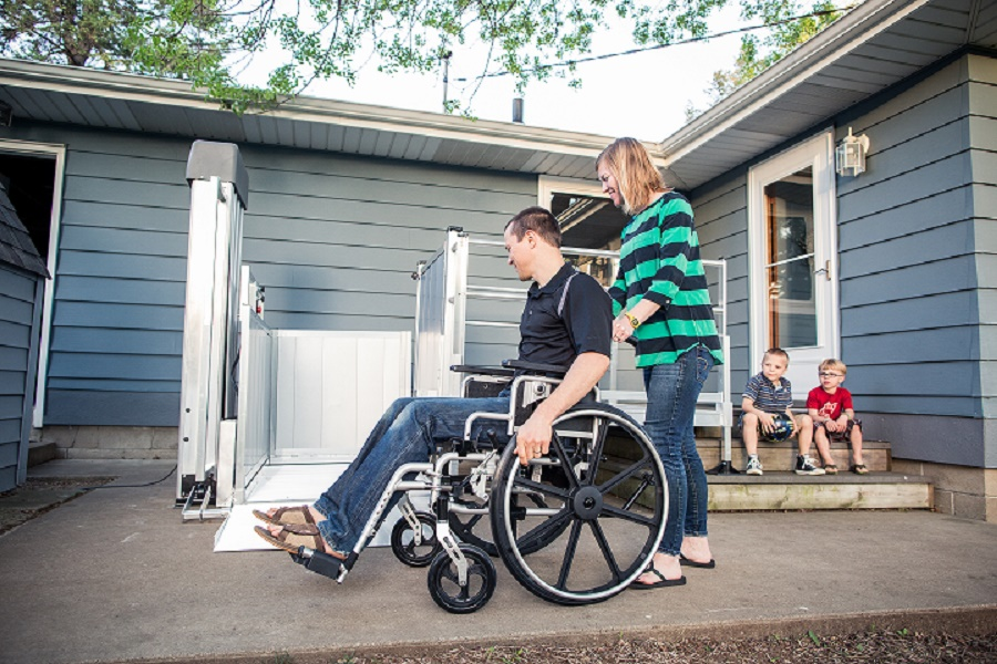 Man in wheelchair using a VPL at home