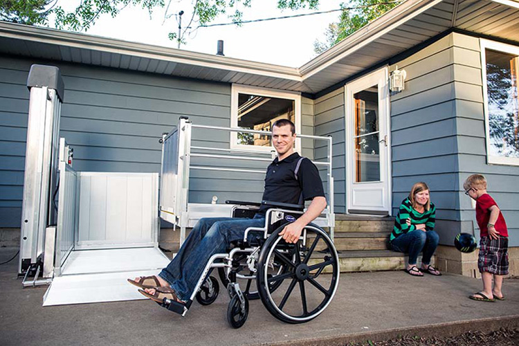 Wheelchaired man using a VPL to access his home