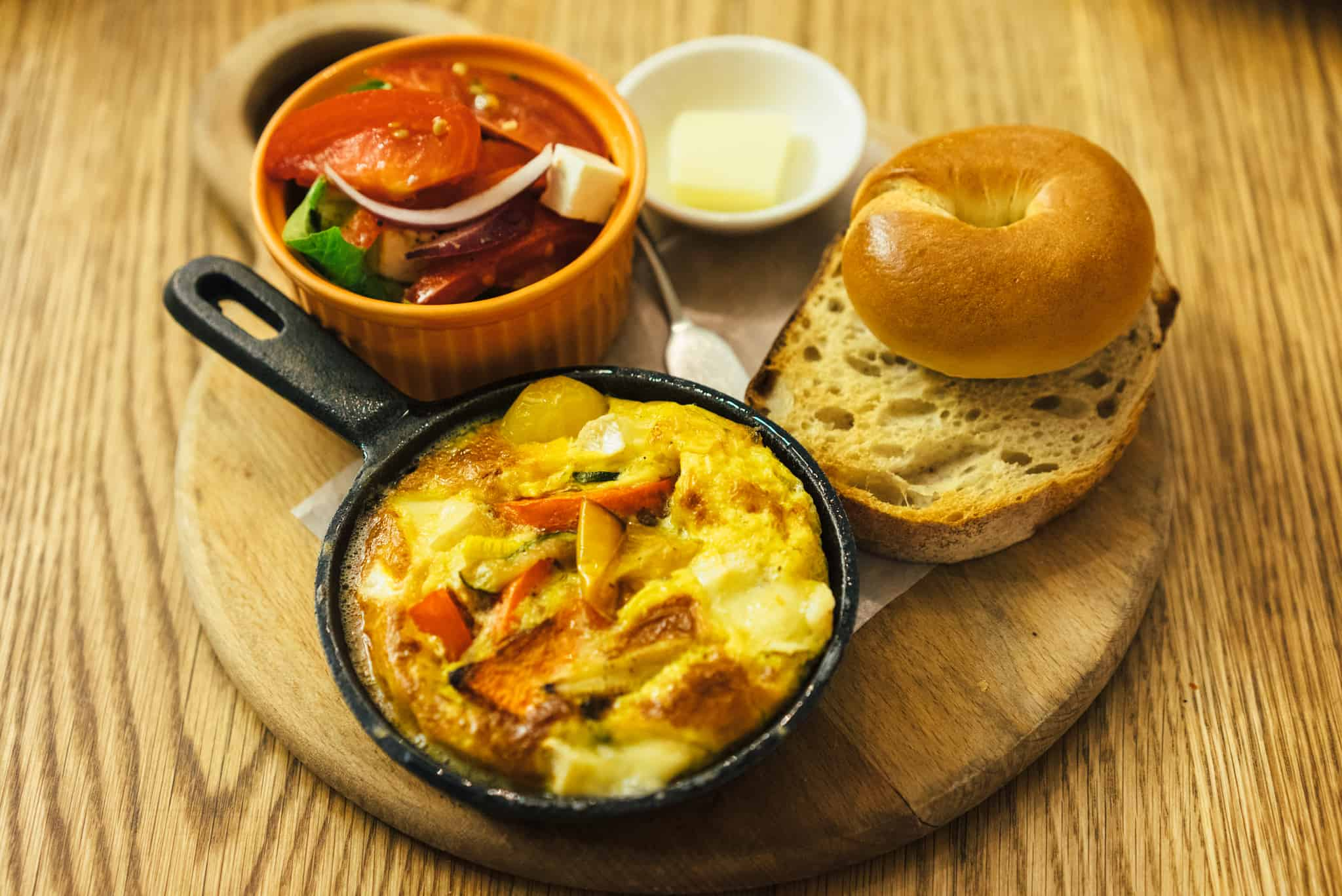 Healthy food options - omelet, toasted bagel, frittata