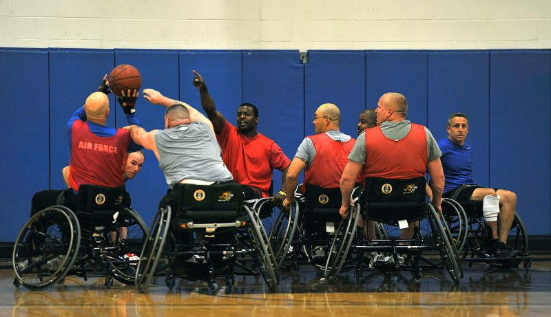 Group of men participating in wheelchair basketball