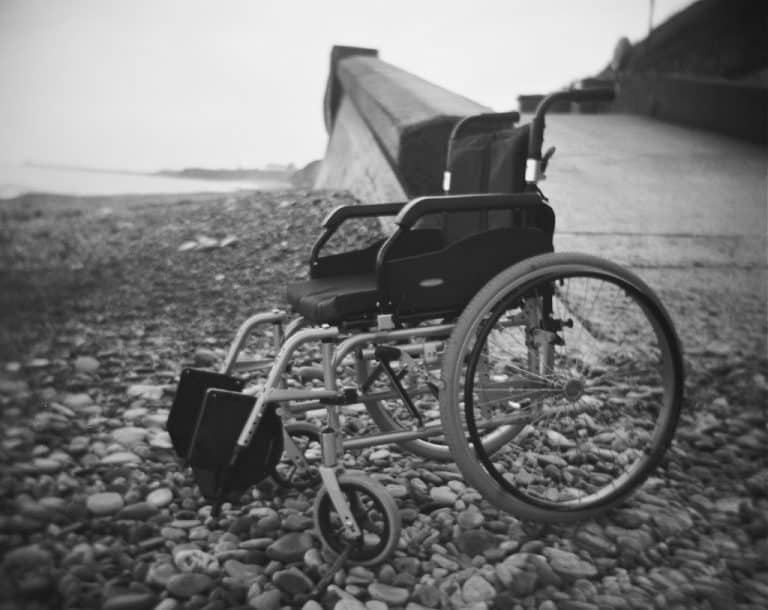 Black and white image of an empty wheelchair