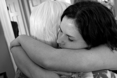 Daughter hugging her mother