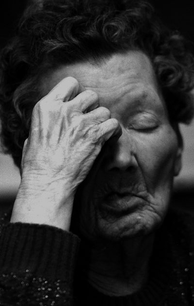 Elderly woman experiencing mental strain